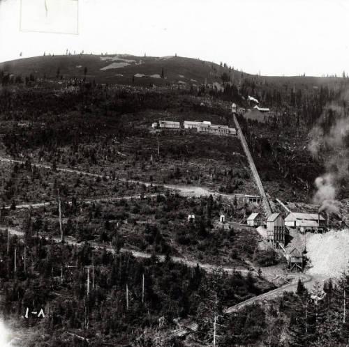Mullan (Idaho), S Bridge Wreck-above Mullan, 1903<br/ >Image shows a train wreck on S Bridge, 1903, above Mullan, Idaho.