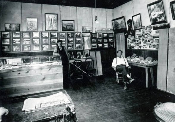 Image of Interior of an office or store displaying many pictures on the wall.
