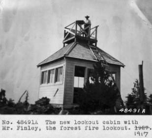 The new lookout cabin with Mr. Finley, the forest fire lookout.<br&gt;282