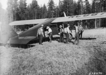 &#34;Emergency guards with packs leaving airplane at Barlett Creek landing field.&#34;<br&gt;75